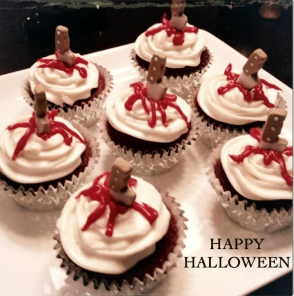 these are my halloween cupcakes i made last year they are also red velvet because they were knife stabbed cupcakes and therefore the insides needed to be